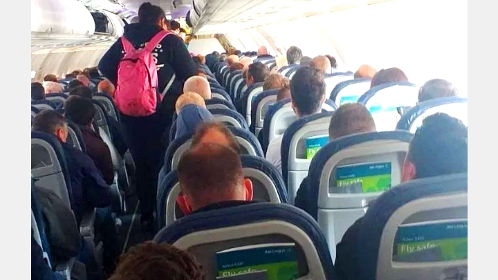 Lottery for life. Will You agree to move in such a crowded plane at this COVID-19 time?